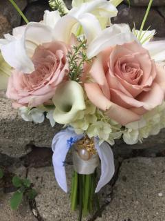 Lily, hydrangea, and rose bouquet