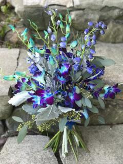 blue orchid and delphinium bouquet